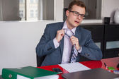 Businessman adjusting tie — Stock Photo