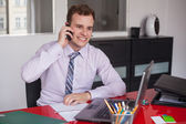 Businessman with laptop and mobile phone — Stock Photo
