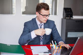 Young businessman in office — Stock Photo