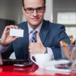 Businessman holding white business card — Stock Photo #44422523