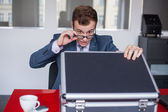 Surprised businessman with briefcase — Stock Photo