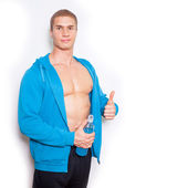 Muscular man with energy drink — Stockfoto