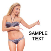 Lady in lingerie pointing copy space — Stock Photo