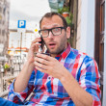 Surprised man on phone — Stock Photo #45073595