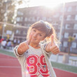 Smiling girl showing thumb up — Stock Photo #45077209