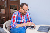 Man with laptop and coffee — Stock Photo