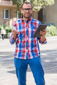 Man with mobile phone and digital tablet — Stockfoto