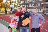 Students showing thumbs down — Stock Photo
