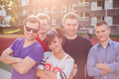 Young smiling students — Stock Photo