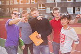 Young students pointing at something — Stock Photo