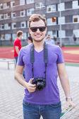 Man with digital camera — Stock Photo
