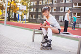 Woman on rollerblades — Stock Photo