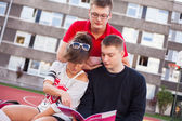 Students reading book — Stock Photo