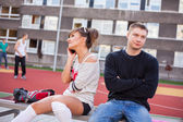 Boy and girl at school field — Stock Photo