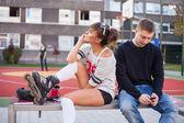 Boy and girl using mobile phones — Stock fotografie
