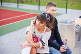 Boy and girl using mobile phones — Stock Photo