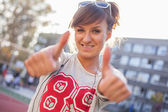 Smiling girl showing thumb up — Foto Stock