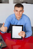 Businessman holding tablet and showing thumb up — Stock Photo