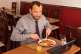 Businessman having lunch — Foto de Stock