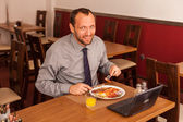 Businessman having lunch — Stock Photo