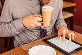 Businessman using tablet — Stock Photo
