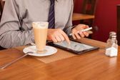 Businessman using mobile phone and tablet — Stock Photo