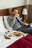 Businessman having breakfast — Stock Photo