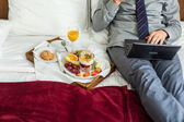 Businessman having breakfast — Stock Photo