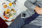 Businessman in hotel room — Stock Photo
