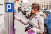 Woman paying for parking — Stock Photo
