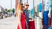 Beautiful couple with shopping bags — Stock Photo