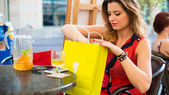 Woman checking her bags — Stockfoto