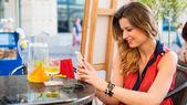 Woman using mobile — Stock Photo