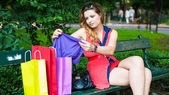 Woman checking shopping bags — Stock Photo