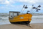 A fishing boat on the Baltic coast — Stock Photo