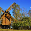 A historic windmill and a wind turbine — Stock Photo