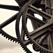 Gears at a historic crane - Stock Photo