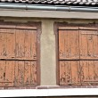 Foto Stock: Shutters on old house