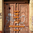 Stock Photo: Locked door of abandoned house