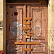 Locked door of abandoned house — Stock Photo #23195104