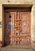 Locked door of an abandoned house — Stock Photo