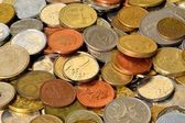 Coins of many countries lie on a table — Stock Photo