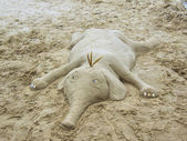 A molded sand elephant on the beach — Stock Photo