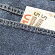 Money in the pocket of a pair of jeans — Stock Photo