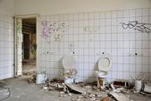Toilets in a disused factory — Stock Photo