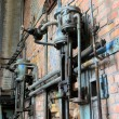 Pipes and fittings in a disused factory — Stock Photo