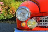 A red classic car on the roadside — Stok fotoğraf