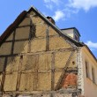 Requiring rehabilitation old half-timbered house — Stock Photo