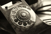 Old telephone on a desk — Stock Photo