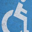 Symbol of a disabled parking space — Stock Photo